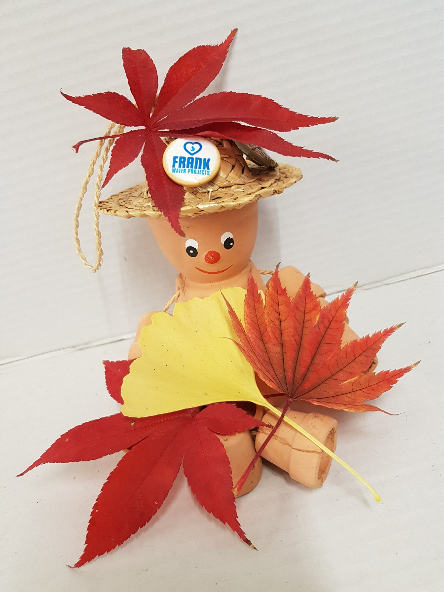Frank the Flower Pot man with autumn leaves