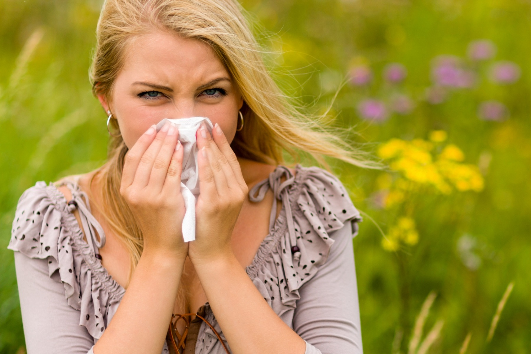 Lady sneezing with hay fever