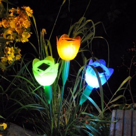 Solar Powered Rainbow Flower Border Light x 4. One of each colour