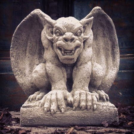 Watch out, here's an Angry Gargoyle garden statue.  Made from reconstituted stone and ready to grumble