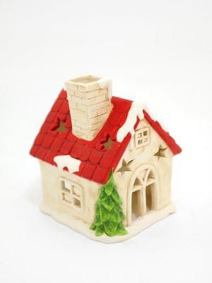 Ceramic Chirstmas cottage tealight holder.  Height 13cm
