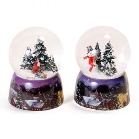 Traditional Glass Snow Globe with Wintry Scene Painted on Ceramic Base. Girl on a Sledge