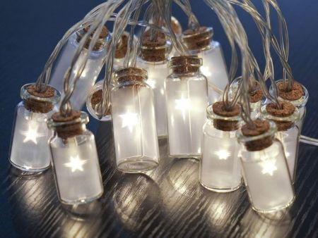 Frosted Glass Jar Garland with 16 Warm White Star LEDs. Battery operated.