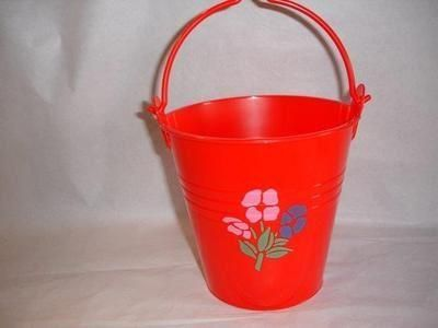 Funky plastic pail with handle and flower print.  Great for young gardeners.[Yellow]