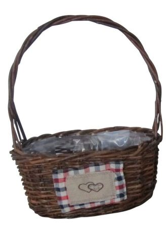 Oval willow baskets with fabric badge and hoop handle.