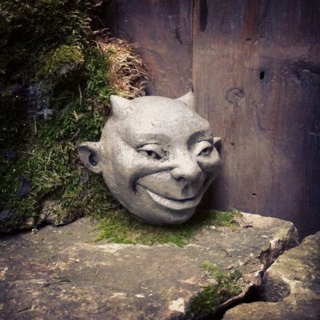 Imp Wall Plaque Garden Ornament. Reconstituted stone
