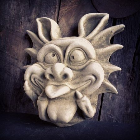 Bony Fingure Grotesque Wall Plaque Made from Reconstituted Stone.