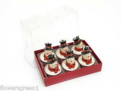 Box of 6 Tealight candle Snowmen with tophats.  Lovely novel gift.