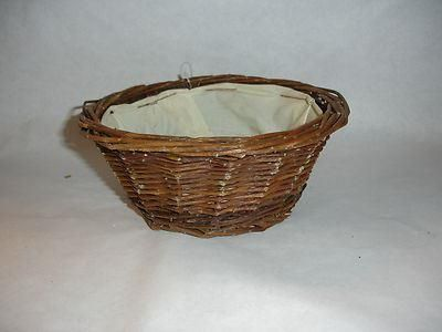 Brown rattan basket lined. 20cm x 8cm