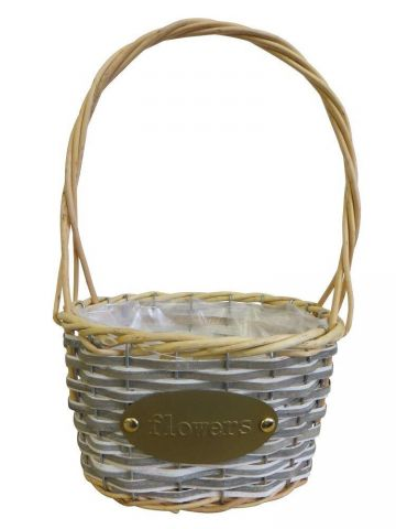 Oval willow and woodchip basket with hoop handle and gold flowers badge