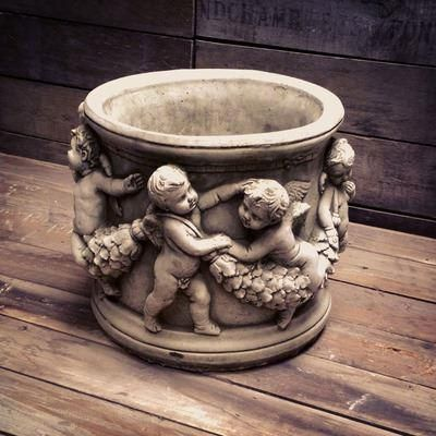 Cherub Pot Made from Reconstituted Stone. 24cm height