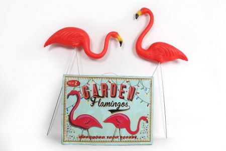 Two garden Flamingos.  Very kitsch ornaments on posts!