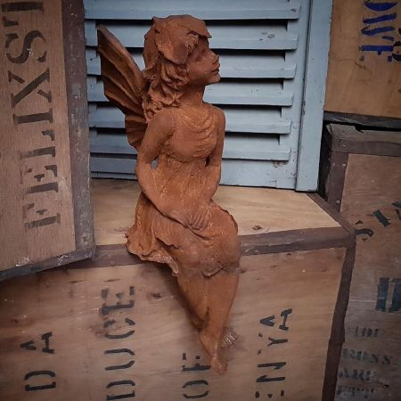 Sitting Fairy made from Cast Irn with Rust Finish to sit on a wall or step 52cm tall