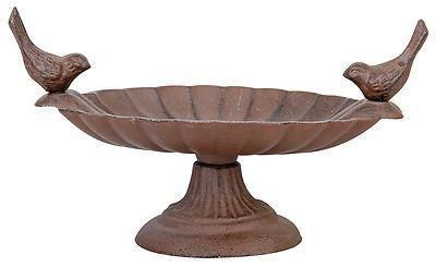 Aged metal bird bath / feeder with two birds.  Very pretty. fb162