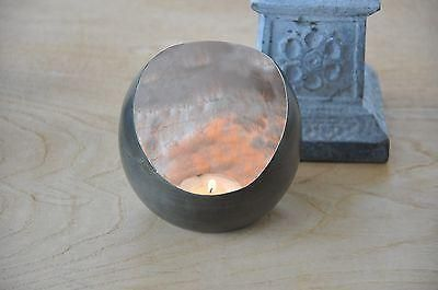 Baltazar metal tealight / candle holder with silver leaf.  Simply stunning.