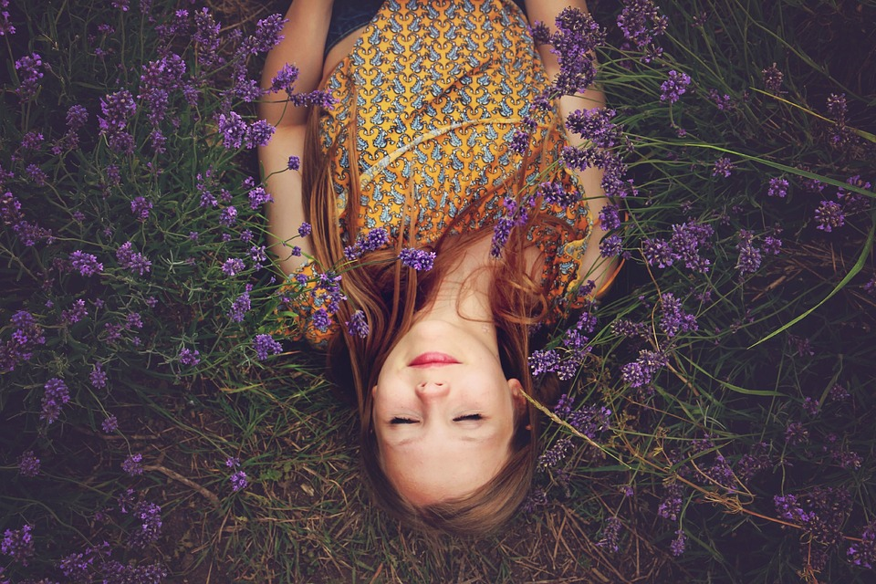 girl lying in lavender flowers