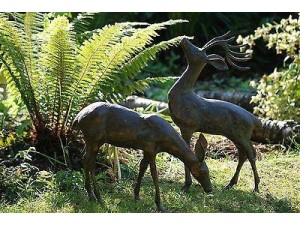 Cast aluminium deer in a garden border, sculpture, statues, give direction