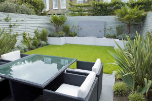 Interesting garden with lawn, planting, walls, structure