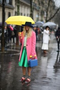 Raining with umbrella and clothes in bright colours