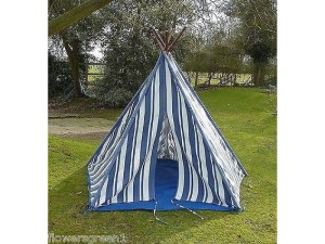 Tent in the garden. Children playing in summer outdoors.