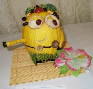 Veg and Fruit character Minion made from melon, broccoli, tomatoes,  beans, grapes