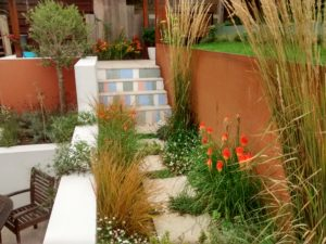 small garden, levels, garden design, steps, explore the garden, planting design, red hot poke, calamagrostis, amelanthe, stepping stones, olive tree, lavender, seating area, terracing,