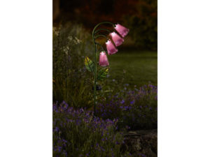 solar garden light ornament in the form of a foxglove flower giving light after dark