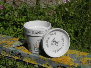 A garden mug by Simon Drew called The Lawn Ranger amusing cup