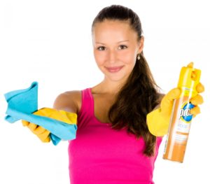 ways to boost your mood includes cleaning the house or the oven or clearing out a cupboard. Lady with cleaning materials