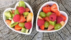 fresh fruit pieces in bowls at christmas offer a healthy alternative to sweets