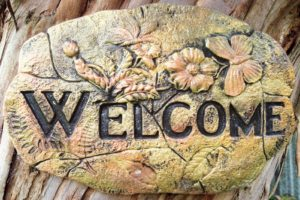 welcome sign to invite people into a garden