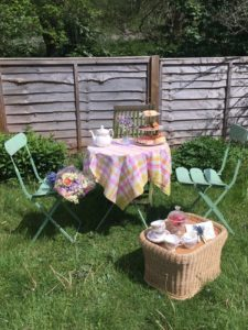 Garden table and two chairs with picnic and afternoon tea
