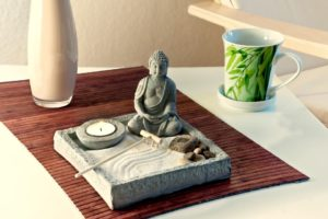 Feng shui board with candle, Buddha, positive karma